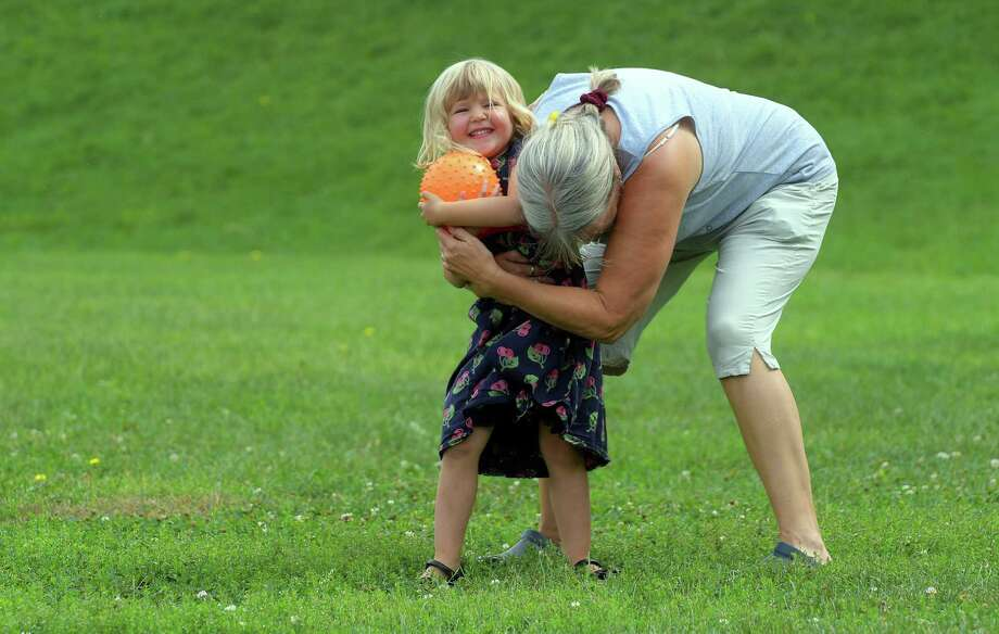 Betsy Mercogliano of Albany plays with her granddaughter, Eleanor Mercogliano Easton, 3, at Lincoln Park on Monday, Sept. 19, 2016, in Albany, N.Y.     (Paul Buckowski / Times Union) Photo: STAFF / 40038080A