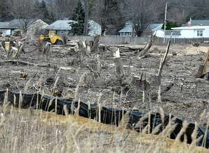 Homes are now exposed, due to mature trees being taken down by developers, on Maxwell Road on Friday, March 25, 2016, in Colonie, N.Y. The Save Colonie's Trees group wants the town to change their approach with development property. (Cindy Schultz / Times Union)