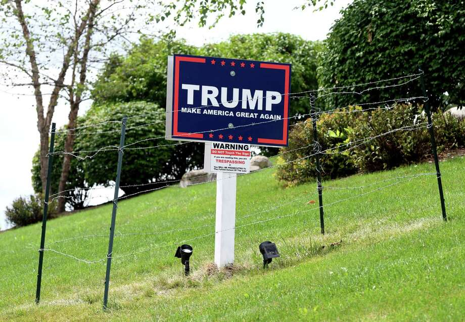 A barbed wire fence and other security measures surround a political lawn sign for Republican presidential candidate Donald J. Trump on Monday, Aug. 15, 2016, on East Hills Blvd in Colonie, N.Y. The property belongs to builder Robert Marini. (Will Waldron/Times Union archive) Photo: Will Waldron / 20037657A