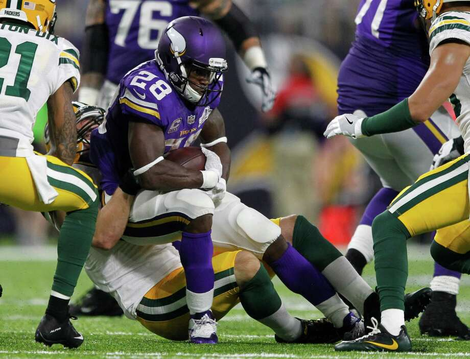 Minnesota Vikings running back Adrian Peterson (28) is tackled by Green Bay Packers outside linebacker Kyler Fackrell, rear, during the second half of an NFL football game Sunday, Sept. 18, 2016, in Minneapolis. Peterson was injured on the play and was helped off the field. (AP Photo/Andy Clayton-King) ORG XMIT: MNCN118 Photo: Andy Clayton-King / FR51399 AP