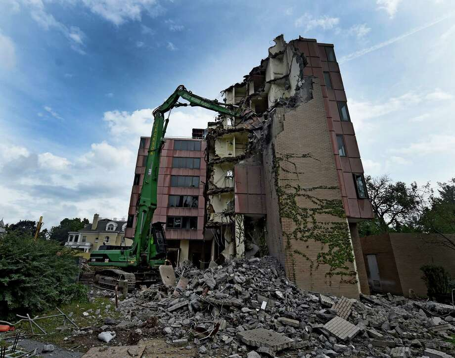 The Jackson Demolition Company is razing Moore Hall, known as the Pink Palace because of the color of its exterior, a former Skidmore College dormitory Monday Sept. 19, 2016 at Lock 8 in Saratoga Springs, N.Y. Developer Sonny Bonacio will build apartments on the site on 1.3 acres on Union Avenue near Circular Street.   (Skip Dickstein/Times Union) Photo: SKIP DICKSTEIN / 40038083A