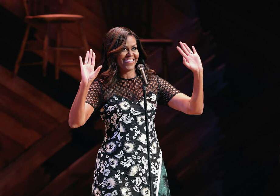 NEW YORK, NY - SEPTEMBER 19:  U.S. First Lady Michelle Obama greets fellow first ladies, students and guests at Broadway's Jacobs Theater on September 19, 2016 in New York City. The event, called the United Nations General Assembly at Broadway's Jacobs Theater, showcased performances by The Color Purple, Waitress, Beautiful, and Wicked. Late Show host Steven Colbert emceed the show. The purpose of the event was to continue to raise awareness for the Let Girls Learn initiative, launched by  President Obama and First Lady in March 2015, to help adolescent girls around the world go to school and stay in school.  (Photo by John Moore/Getty Images) ORG XMIT: 670201311 Photo: John Moore / 2016 Getty Images