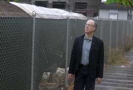 Don Falk walks past a vacant lot at 1300 Fourth Street at Mission Bay in San Francisco, Calif. on Thursday, Nov. 13, 2014. Falk is executive director of the Tenderloin Neighborhood Development Corporation, which just received the green light to build 135 affordable housing units on the property.