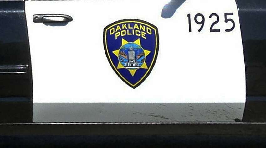 This July 24, 2013 file photo shows an Oakland, Calif., Police Department cruiser on the scene of a shooting in Oakland.