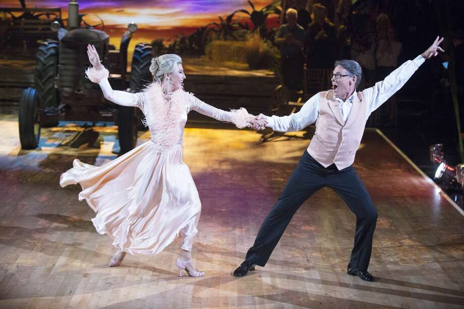 Former Texas Gov. Rick Perry made like Eddie Albert and his partner Emma Slater mimicked Eva Gabor in a quickstep to the theme from 'Green Acres' on TV night of 'Dancing with the Stars.' MONDAY, SEPTEMBER 19 on the ABC Television Network. (ABC/Eric McCandless) Photo: Eric McCandless/ABC