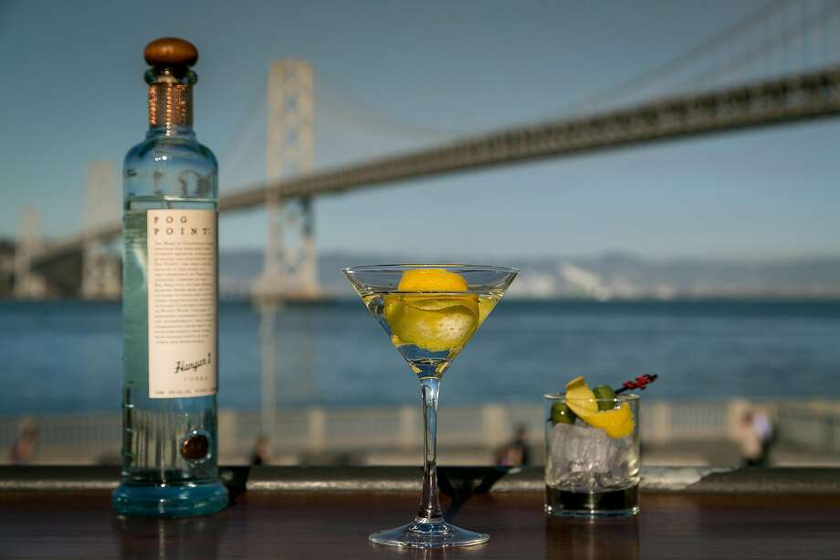 EPIC Steak's view of the Bay Bridge and their Fog Point Vodka Martini and Shrimp Cocktail. Photo: John Storey, Special To The Chronicle