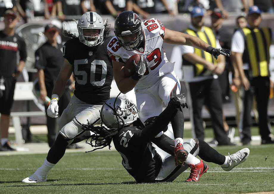 Atlanta   tight end Jacob Tamme (83), defended by Raiders free safety Reggie Nelson (27) and linebacker Ben Heeney, and other Falcons receivers were continually open Sunday in Oakland. Photo: Marcio Jose Sanchez, Associated Press