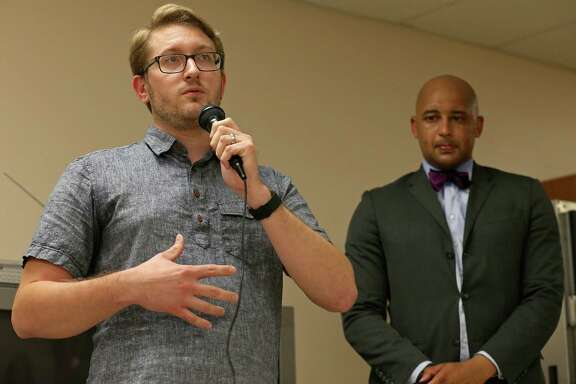 Dignowity Hill neighborhood resident Brian Willeford (left) speaks as District 2 Councilman Alan Warrick and others listen during the Dignowity Hill Neighborhood Association Meeting held Monday Sept. 19, 2016 at the Ella Austin Community Center.