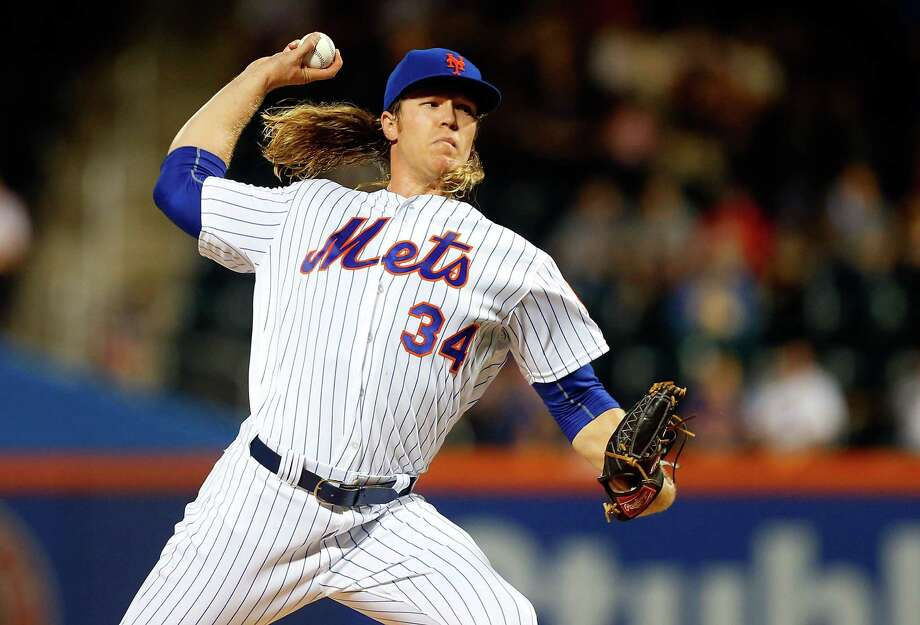 NEW YORK, NY - SEPTEMBER 19:  Noah Syndergaard #34 of the New York Mets pitches in the first inning against the Atlanta Braves at Citi Field on September 19, 2016 in the Flushing neighborhood of the Queens borough of New York City.  (Photo by Jim McIsaac/Getty Images) ORG XMIT: 607685435 Photo: Jim McIsaac / 2016 Getty Images