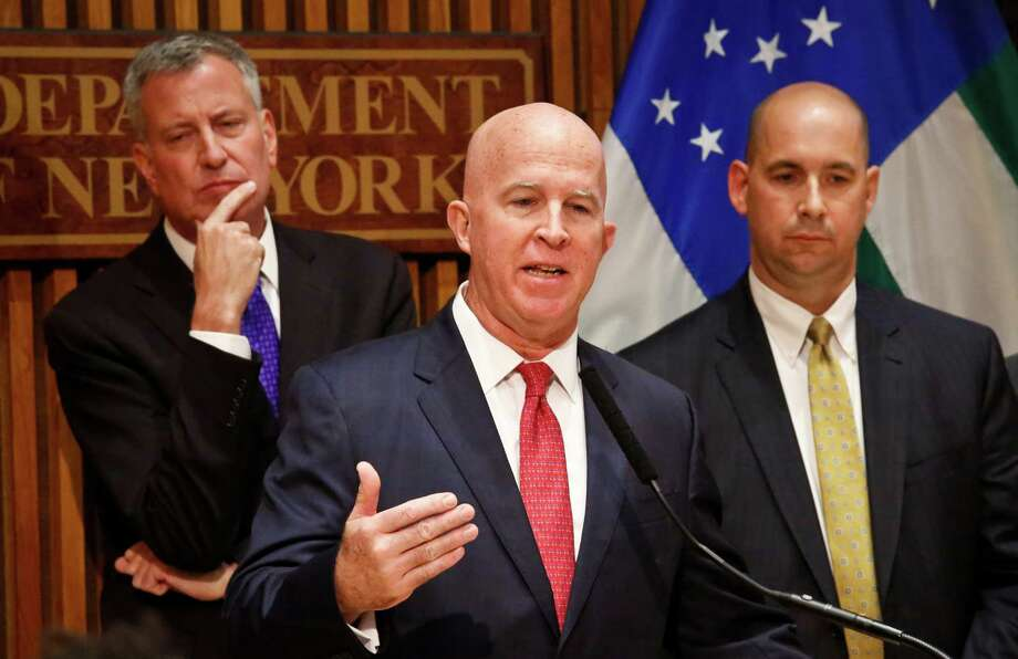 Mayor Bill de Blasio, left, New York Police Department Commissioner James O'Neill, center, and FBI Assistant Director Bill Sweeney, right, hold a news conference announcing the arrest of bombing suspect Ahmad Kahn Rahami, Monday Sept. 19, 2016, at police headquarters in New York. (AP Photo/Bebeto Matthews) ORG XMIT: NYBM110 Photo: Bebeto Matthews / Copyright 2016 The Associated Press. All rights reserved.