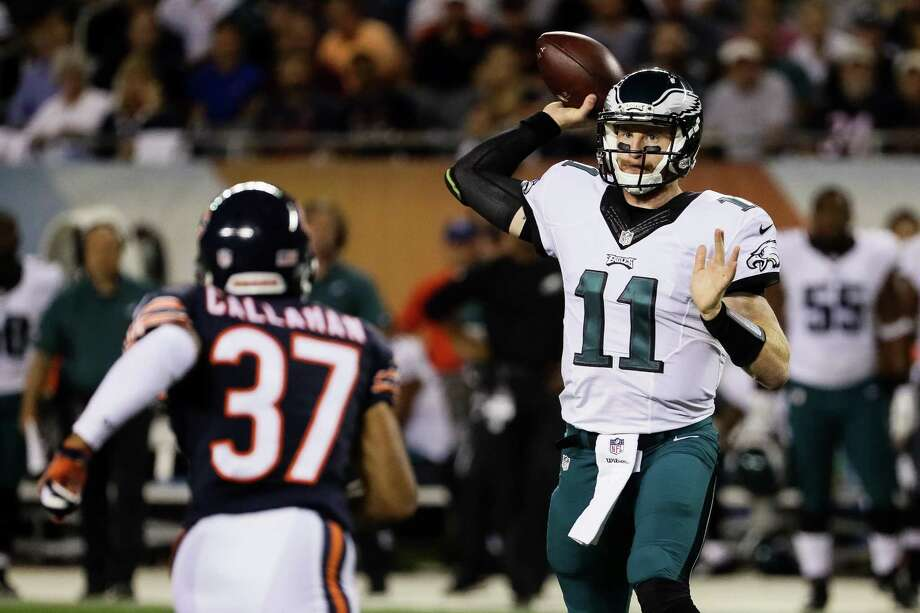 CHICAGO, IL - SEPTEMBER 19:  Quarterback Carson Wentz #11 of the Philadelphia Eagles looks to pass in the first quarter against the Chicago Bears at Soldier Field on September 19, 2016 in Chicago, Illinois.  (Photo by Jonathan Daniel/Getty Images) ORG XMIT: 659050167 Photo: Jonathan Daniel / 2016 Getty Images