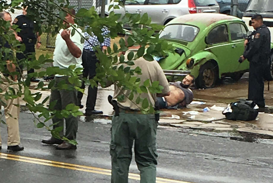 Ahmad Khan Rahami is taken into custody after a shootout with police Monday, Sept. 19, 2016, in Linden, N.J. Rahami was wanted for questioning in the bombings that rocked the Chelsea neighborhood of New York and the New Jersey shore town of Seaside Park. (Moshe Weiss via AP) ORG XMIT: NY202 / Moshe Weiss