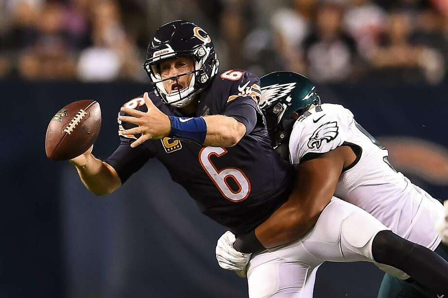Quarterback Jay Cutler #6 of the Chicago Bears fumbles against Destiny Vaeao of the Philadelphia Eagles in the second half at Soldier Field in Chicago. Photo: Stacy Revere, Getty Images