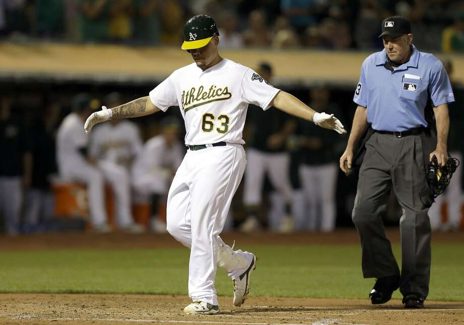 Oakland Athletics' Bruce Maxwell (63) celebrates after hitting a home run off Houston Astros pitcher Brad Peacock in the second inning of a baseball game Monday, Sept. 19, 2016, in Oakland, Calif. (AP Photo/Ben Margot) Photo: Ben Margot, Associated Press