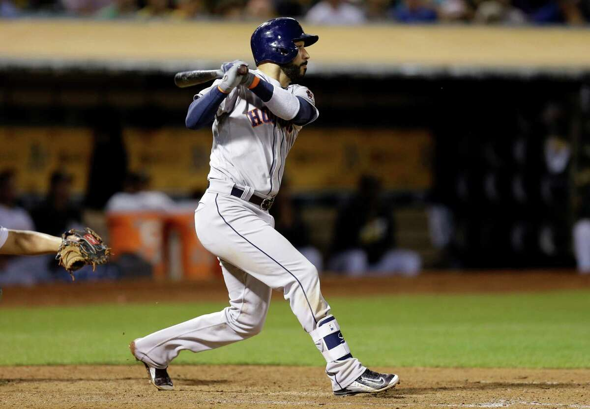 Houston Astros' Marwin Gonzalez swings for a two run single against the Oakland Athletics in the ninth inning of a baseball game Monday, Sept. 19, 2016, in Oakland, Calif. (AP Photo/Ben Margot)