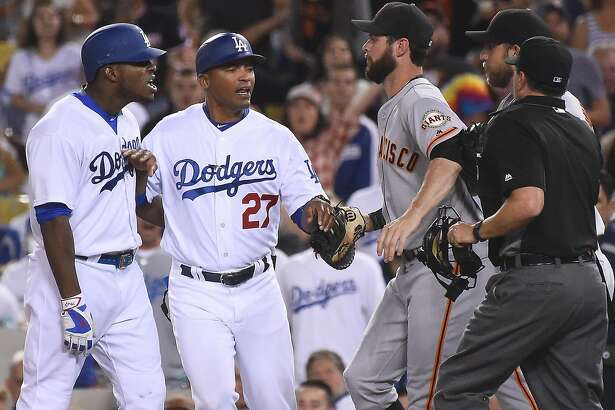 LOS ANGELES, CA - SEPTEMBER 19:  George Lombard #27 of the Los Angeles Dodgers gets in-between Yasiel Puig #66 of the Los Angeles Dodgers and Brandon Belt #9 of the San Francisco Giants and Madison Bumgarner #40 of the San Francisco Giants after words were exchanged after the final out of the seventh  inning of the game at Dodger Stadium on September 19, 2016 in Los Angeles, California. (Photo by Jayne Kamin-Oncea/Getty Images)