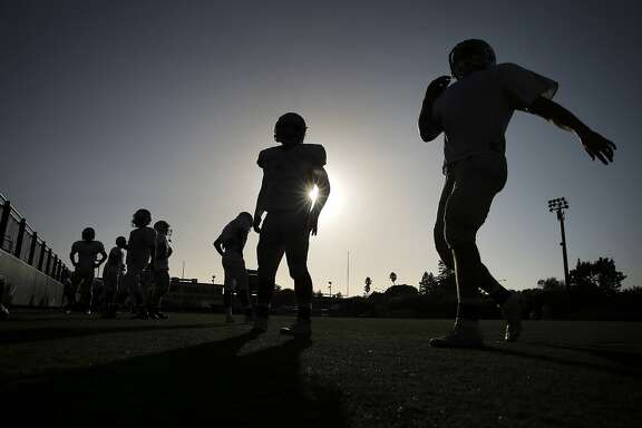De La Salle Spartan players run sprints during varsity football practice at De La Salle High School in Concord, Calif., on Tuesday, September 13, 2016. De La Salle plays Antioch High School in a game pitting two bay area football powerhouses, and stopping Najee Harris is the first priority for the Spartans.