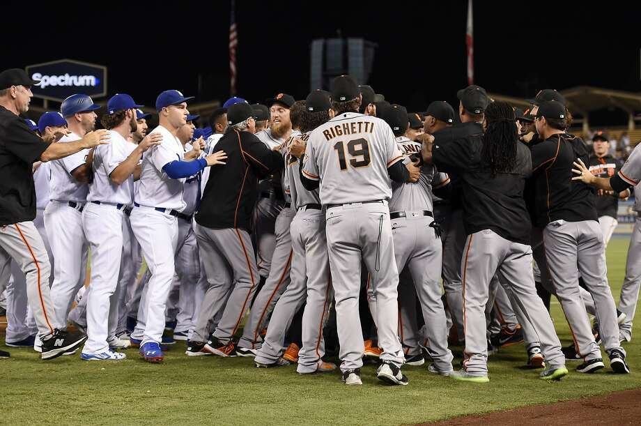 Members of the San Francisco Giants and the Los Angeles Dodgers scuffle after Dodgers' Yasiel Puig was thrown out at first by Giants starting pitcher Madison Bumgarner during the seventh inning of a baseball game, Monday, Sept. 19, 2016, in Los Angeles. (AP Photo/Mark J. Terrill) Photo: Mark J. Terrill, Associated Press