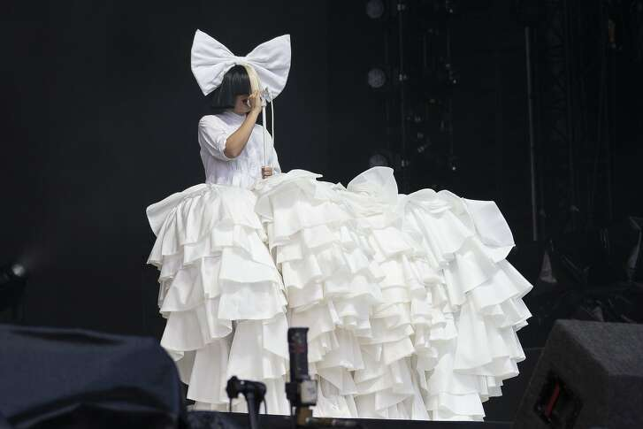 Singer Sia performs as part of the V Festival at Hylands Parks, Chelmsford, Saturday, Aug 20, 2016. (Joel Ryan/Invision/Ap)