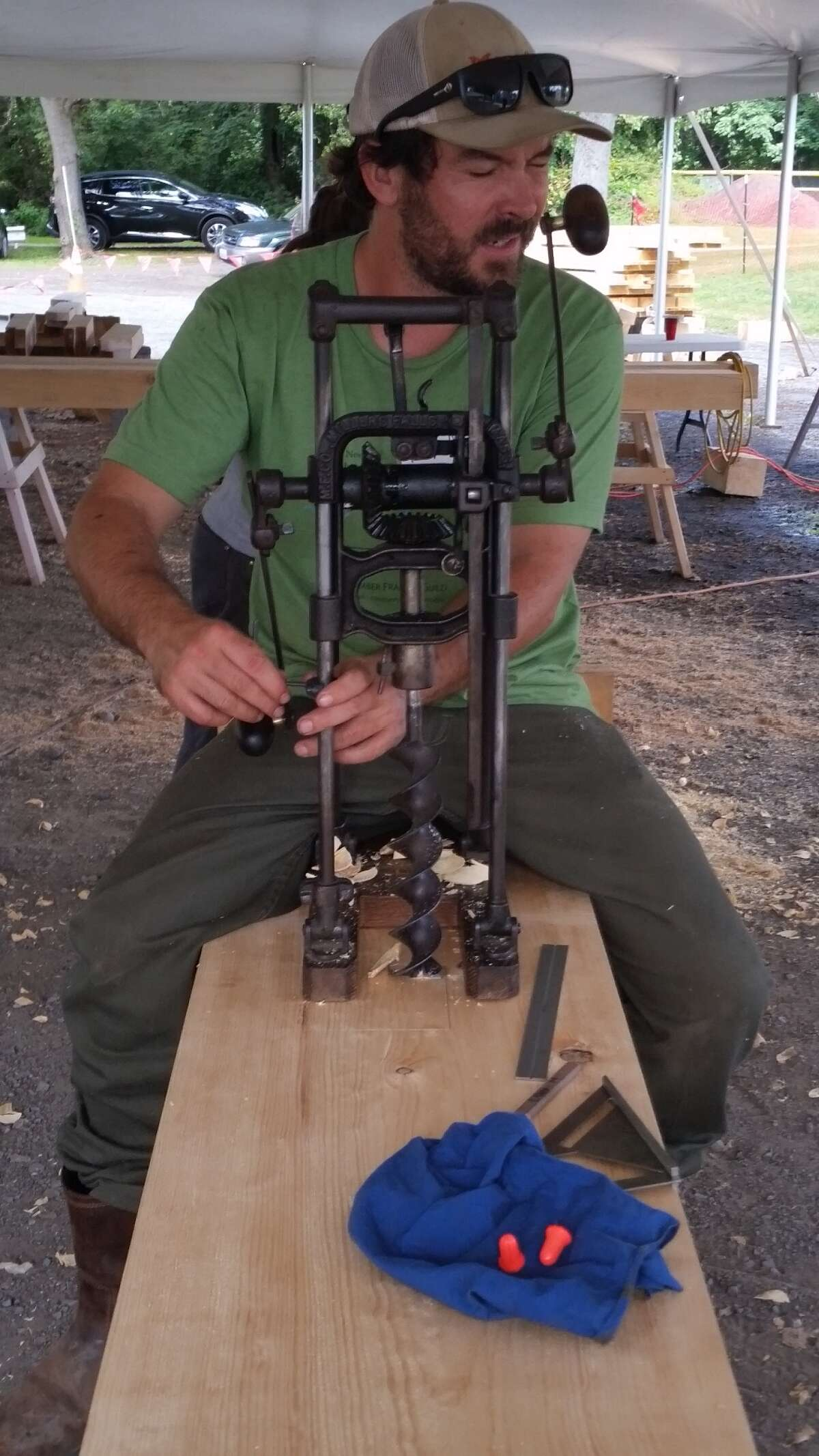 A craftsman with the Timber Framers Guild participates in a workshop with Historic Hudson-Hoosic Partnership last Wednesday SEPT 14 at Fort Hardy Park in Schuylerville to prepare beams for the raising of an original timber frame structure that will be the home of the new Champlain Canal Gateway Visitors Center.