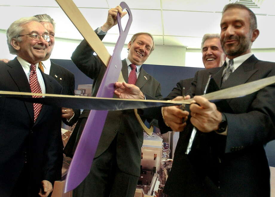 Back in 2003, Veeco Instruments was a key player in SUNY Poly's ability to attract Sematech to Albany. In this photo, Edward H. Braun, the then CEO of Veeco left, is pictured with  Albany Mayor Jerry Jennings, Gov. George E. Pataki, center, Senate Majority leader Joseph L. Bruno, and Alain E. Kaloyeros, right, during a ribbon cutting to announce the signing of a contract between UAlbany and Sematech for the creation of a $403M R&D center. SUNY Poly at the time was part of UAlbany. Source: Times Union archive. Photo: WILL WALDRON / ALBANY TIMES UNION
