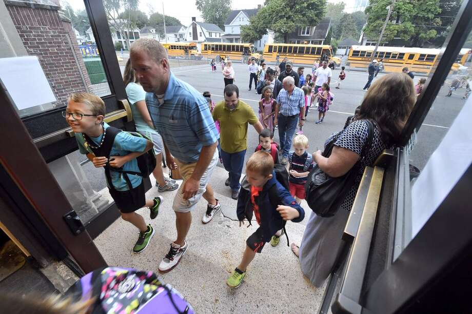 Men participate in National Dads Take Your Child to School Day on Tuesday, Sept. 20, 2016, at Troy School 18. (Skip Dickstein/Times Union)
