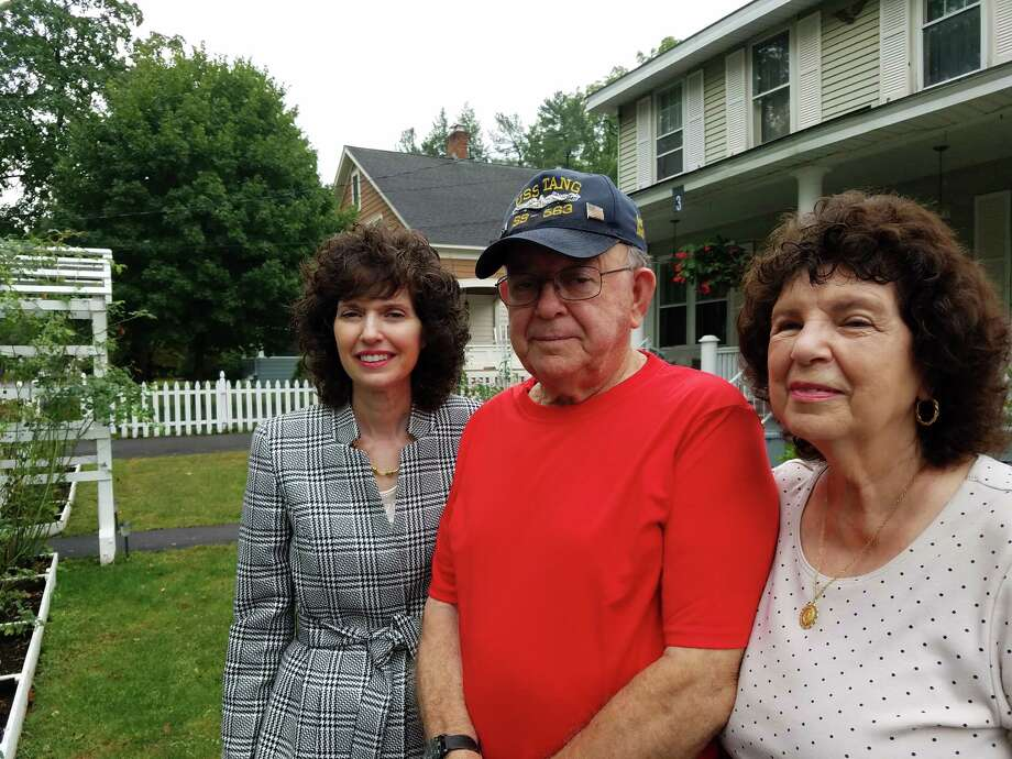 The Santiago family of 3 Bedell Ave., Delmar, opposes a proposed 16-apartment complex that would abut their backyard. From left, Jody, Anthony and Florence Santiago. (Cathleen F. Crowley, Times Union)
