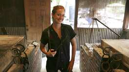 Pitmaster Laura Loomis of Two Bros. BBQ Market is one of the very few female pitmasters in the country.