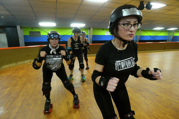 Lauriann Beggs and other new skaters practice side-stepping as the Spindletop Rollergirls and team trainers kicked off their Beginners Boot Camp Monday night at Manning's Texas on Wheels Skating Rink in Beaumont. The six-week course, which is held Monday and Wednesday nights, offers skating instruction, how to fall properly and stop, as well as the rules and strategies of roller derby. Participants will not only learn more about the sport, but can advance to the recreation league, and eventually try out to join the team, which competes throughout the region. Roller derby continues to thrive since the sport saw a resurgence in popularity in the 1990's.  Photo taken Monday, September 19, 2016 Kim Brent/The Enterprise