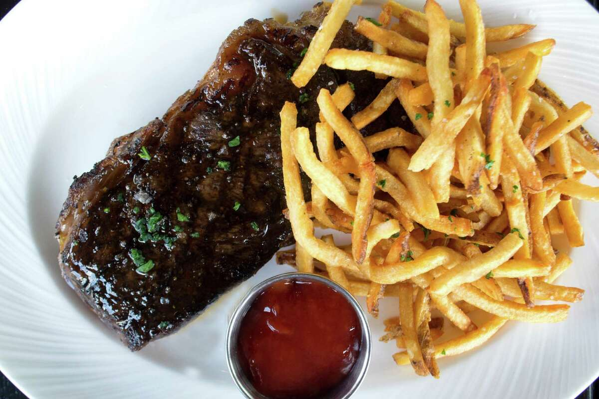 SaltAir Seafood Kitchen on Kirby is adding new brunch and lunch service. Shown: Steak frites (broiled strip steak with steak sauce and french fries) from chef Brandi Key's new lunch menu.