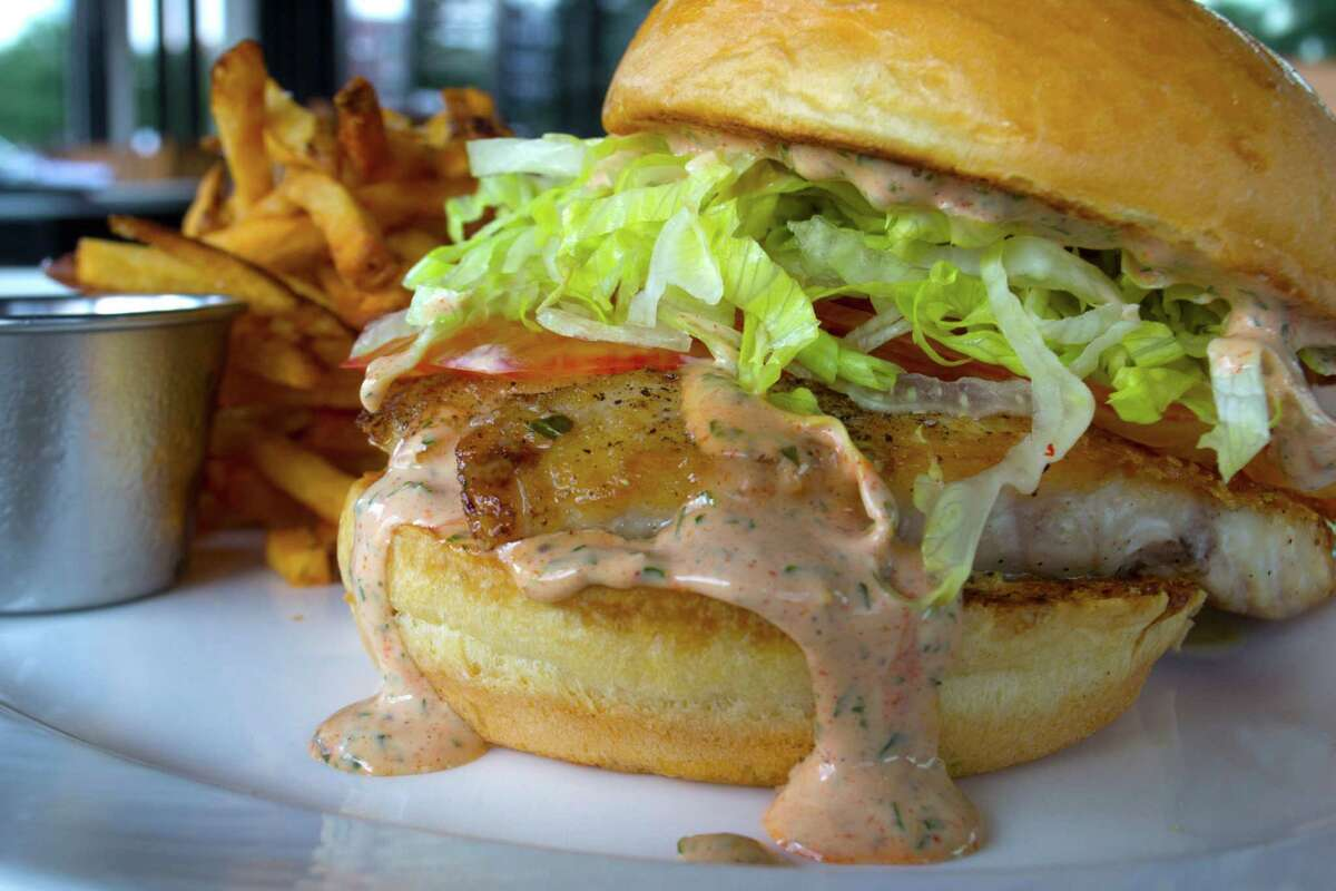 SaltAir Seafood Kitchen on Kirby is adding new brunch and lunch service. Shown: Grilled fish sandwich on brioche bun with remoulade, shredded lettuce, tomato and pickle served with french fries from chef Brandi Key's new lunch menu.