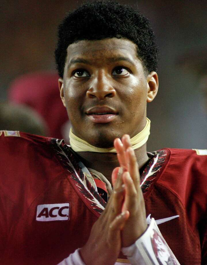 In this Sept. 21, 2013, file photo, Florida State quarterback Jameis Winston watches from the sidelines during the second half against Bethune-Cookman in Tallahassee, Fla. Search warrants, released Dec. 5, 2013, in the sexual assault investigation of Winston indicate the woman told police she was raped at an apartment after a night of drinking at a bar. State Attorney Willie Meggs said there was not enough evidence to pursue charges in the sex assault case against Winston. Photo: Phil Sears /Associated Press / FR170567 AP