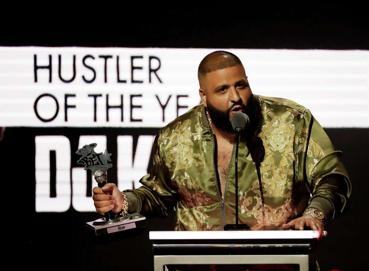DJ Khaled receives the Hustler of the Year award at the BET Hip Hop Awards in Atlanta, Saturday, Sept. 17, 2016. (AP Photo/David Goldman)