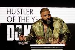 DJ Khaled receives the Hustler of the Year award at the BET Hip Hop Awards in Atlanta, Saturday, Sept. 17, 2016. (AP Photo/David Goldman)