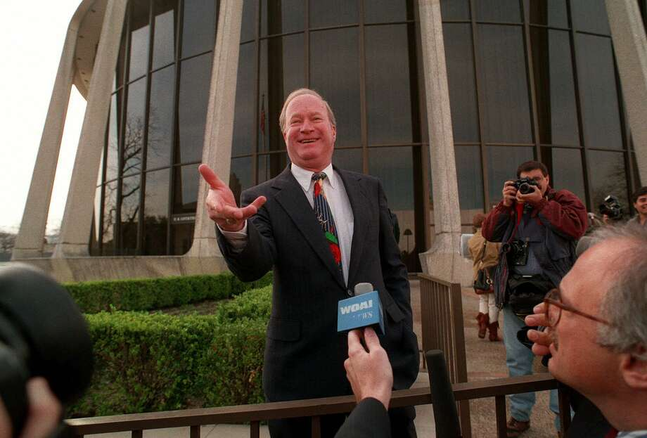 U.S. District Judge Walter Smith talks to reporters outside the federal courthouse in San Antonio when he was presiding over the Branch Davidian lawsuit trial in 1994. Photo: DAVID J. PHILLIP /AP / AP