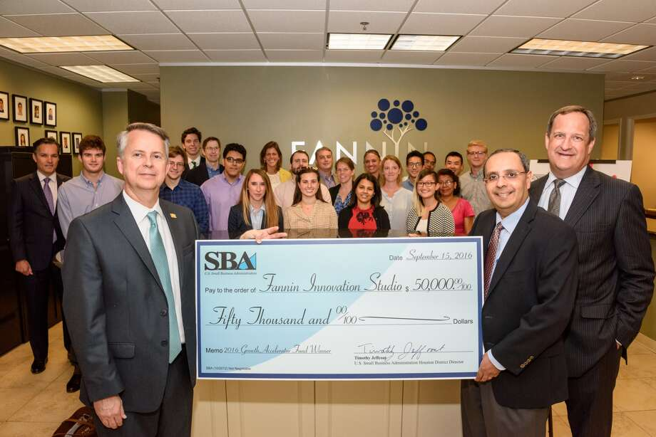 SBA's Houston District Director Tim Jeffcoat, left, presents $50,000 to Fannin Innovation Studio Managing Partner Atul Varadhachary, second from right, and Fannin Innovation Studio Chief Financial Officer Mark Worscheh, right. Fannin Innovation Studio is among the 68 winners of SBA's third annual Growth Accelerator Fund Competition.
