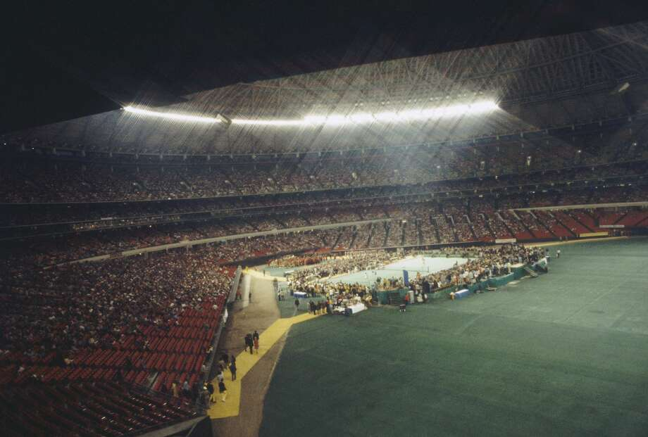 """Billie Jean King in a match against Bobby Riggs in front of 30,472 spectators at the Houston Astrodome on September 20, 1973 in Houston, Texas. King defeated Riggs in three straight sets 6-4, 6-3, and 6-3, winning the match which came to be known as """"The Battle Of The Sexes"""". (Focus on Sport/Getty Images) Photo: Focus On Sport/Focus On Sport/Getty Images"""