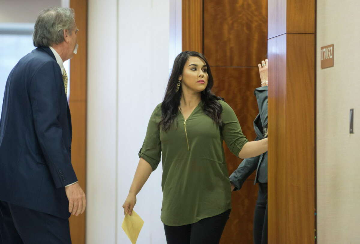Former teacher Alexandria Vera, 24, center, accused of having a sexual relationship with a 13-year-old student, walks out of the 209th district court, Tuesday, Sept. 20, 2016, in Houston. Vera's case has been rescheduled by State District Judge Michael McSpadden.