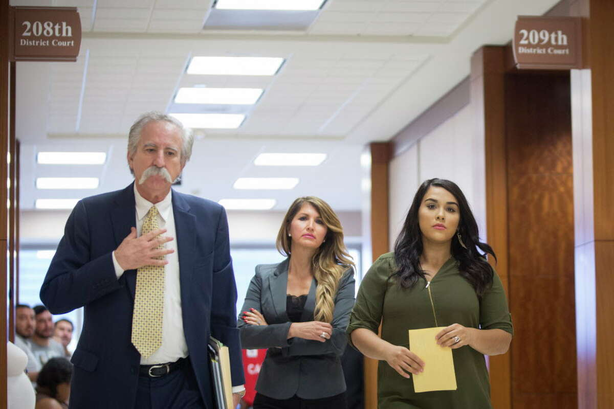 Former teacher Alexandria Vera, 24, right, accused of having a sexual relationship with a 13-year-old student, walks out of the 209th district court after her case was reset Tuesday, Sept. 20, 2016, in Houston. Vera appeared in court accompanied by a family member and her attorney Ricardo Rodriguez, left.