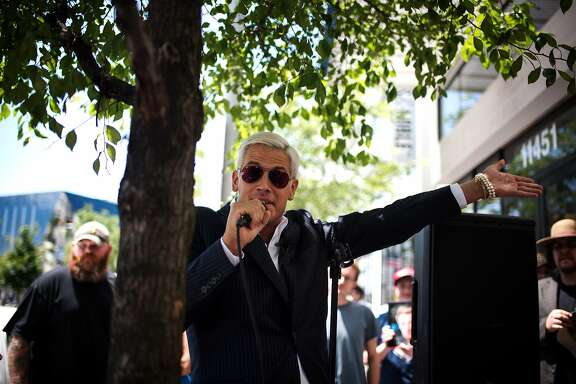 FILE Ñ Milo Yiannopoulos, the Breitbart writer and ÒAlt-RightÓ personality, speaks with reporters at the Republican National Convention in Cleveland, July 19, 2016. As Breitbart grows in influence, some of the conspiracy-minded news siteÕs writers are under increased scrutiny; Yiannopoulos was banned from Twitter in July for stoking online harassment campaigns. (Hilary Swift/The New York Times)