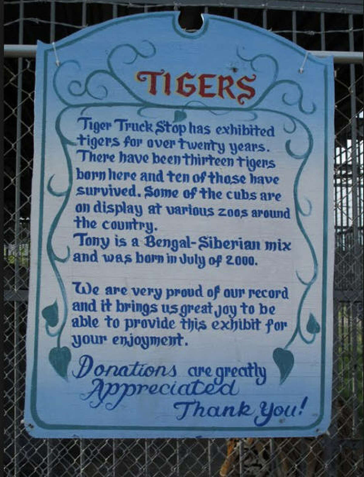 Donations requested A sign outside the Tiger Truck Stop in Grosse Tete, La., asks visitors for money to take care of Tony, a Bengal tiger living at the fueling station and store, September 2016.