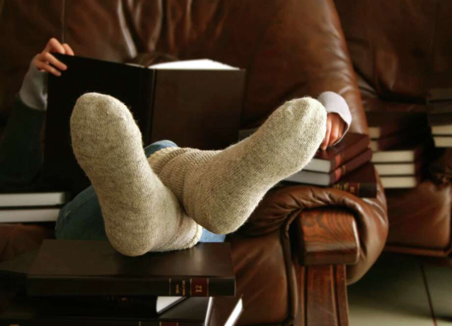 "The Danish tradition of ""hygge"" translates into a coziness of the soul, where you find in joy in curling up with a good book and comfy socks. Photo: MariannaSaska /Getty Images / MariannaSaska"