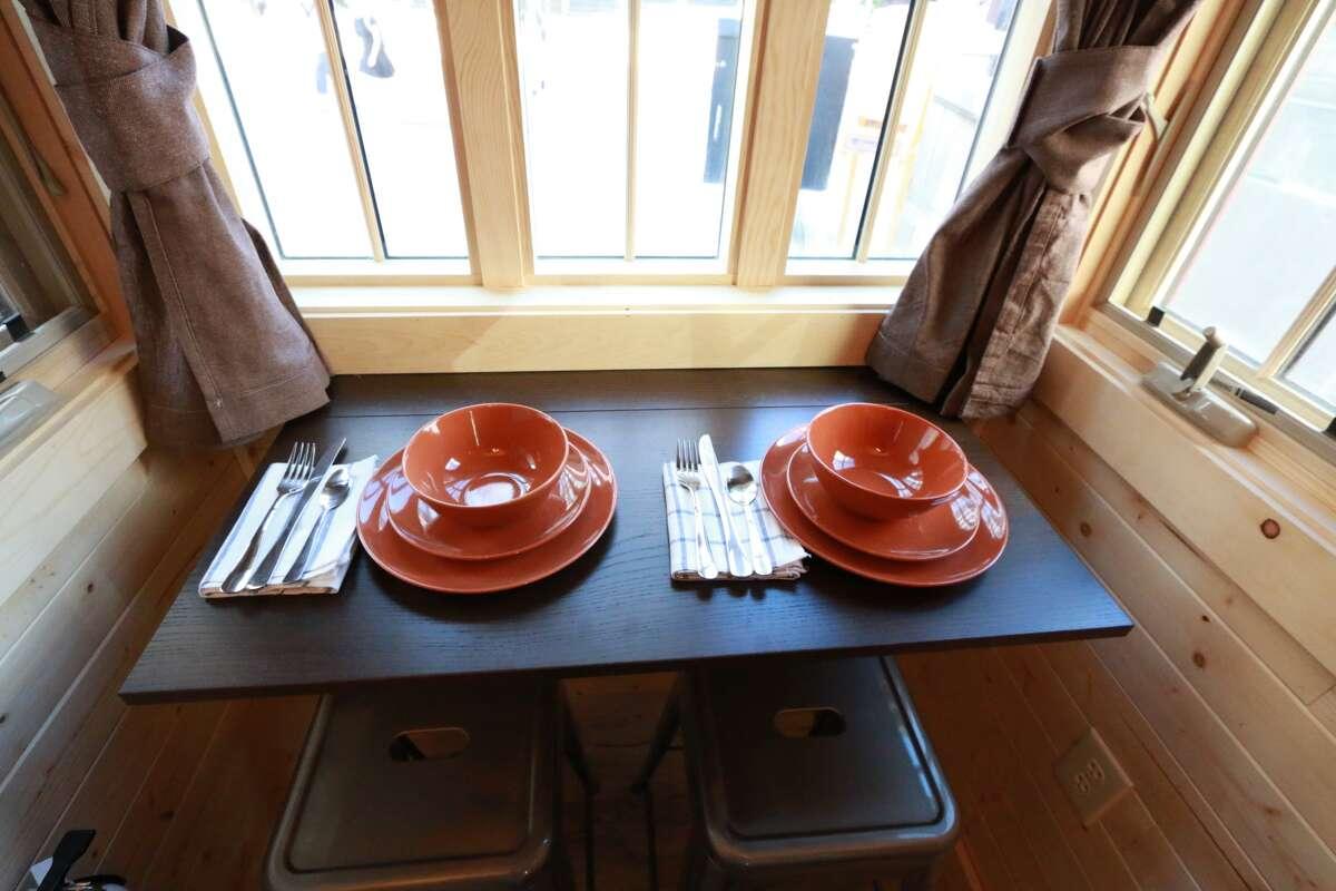 The Finn tiny house model has a compact dining area.