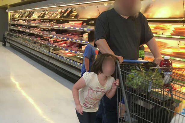 Shopper Erika Burch took these photos of a man pulling a little girl along by her hair while shopping at the Cleveland Walmart on Monday, Sept. 19.