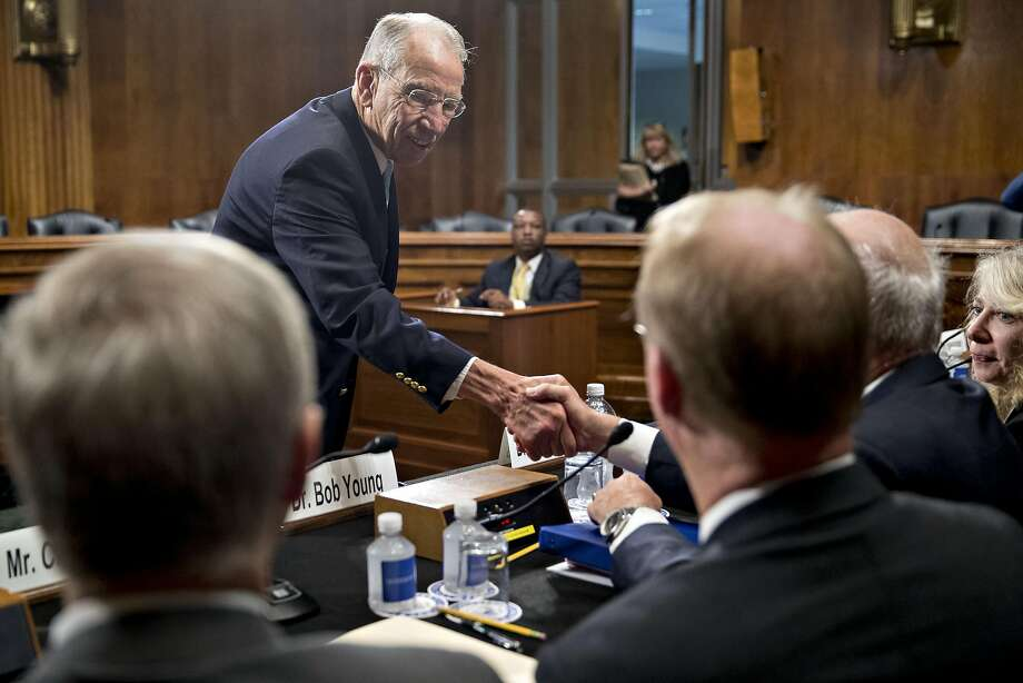 "Senator Charles ""Chuck"" Grassley, a Republican from Iowa and chairman of the Senate Judiciary Committee, shakes hands with witnesses before starting a hearing in Washington, D.C., U.S., on Tuesday, Sept. 20, 2016. The hearing was titled Consolidation and Competition in the U.S. Seed and Agrochemical Industry. Photographer: Andrew Harrer/Bloomberg Photo: Andrew Harrer, Bloomberg"