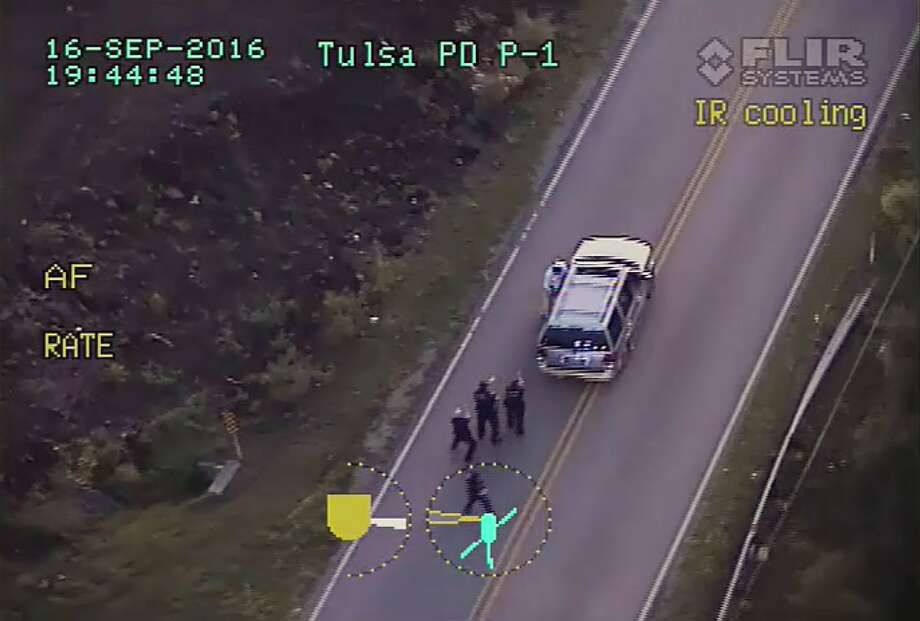A police video shows Terence Crutcher (top) being pursued by police officers as he walk to his SUV. Photo: Associated Press