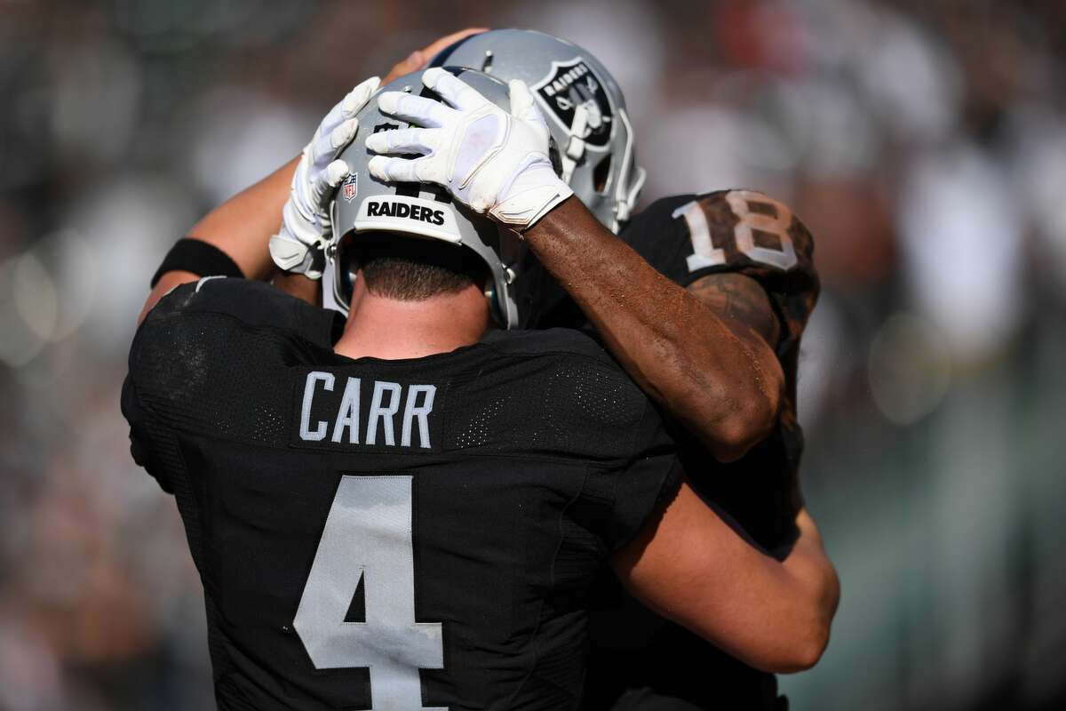 Oakland (1-1) plus-1½ at Tennessee (1-1) Raiders 30-23