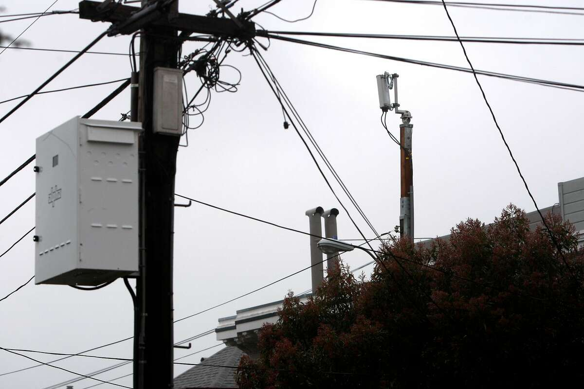 A Next G wireless antenna installed a few months ago reaches over homes and telephone wires in the Sea Cliff neighborhood in San Francisco, Calif., on Sunday, March 6, 2011. On certain days the antenna can reach noise levels of an idling car.