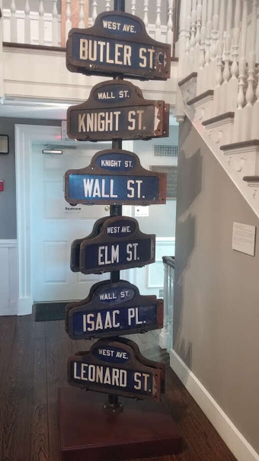 Vintage Norwalk street signs at the Norwalk Historical Society. Photo: Frank Whitman / For Hearst Connecticut Media
