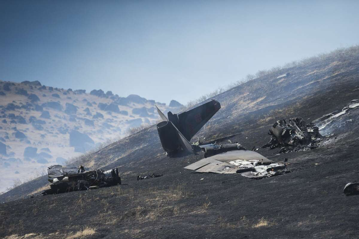 The wreckage of a U-2 spy plane that crashed after taking off from Beale Air Force Base on a training mission in Northern California, is seen Tuesday, Sept. 20, 2016. Authorities say two pilots ejected before the crash Tuesday morning in the Sierra Buttes about 60 miles north of Sacramento. The plane was destroyed and a resulting fire scorched several acres. (Hector Amezcua/The Sacramento Bee via AP)